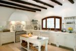 Kitchen interior of large spanish villa. With wooden rafters on the ceiling.