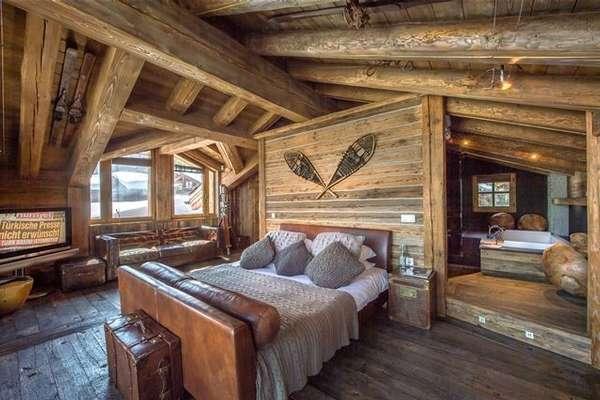 Минимализм и функциональность в обстановке спальни-шале