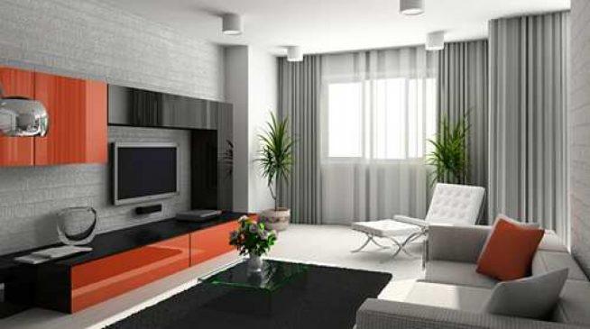 Гостиная с корпусной мебелью в чёрных и оранжевых тонах