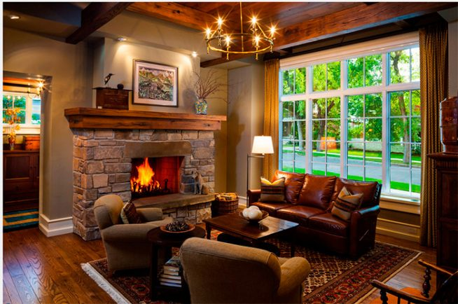Дизайн гостиной в теплых тонах с камином