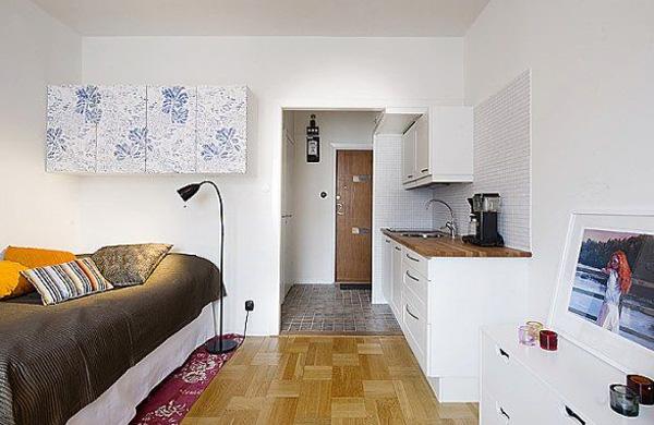 В интерьере небольшой комнаты функциональная мебель