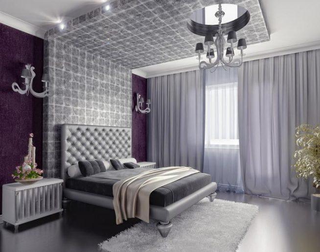 спальня в стиле арт деко в серых и сиреневых тонах, с большой кроватью, люстрой, интересной прикроватной полкой