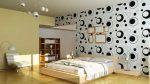 Комбинация обоев с разной фактурой и цветом в спальне