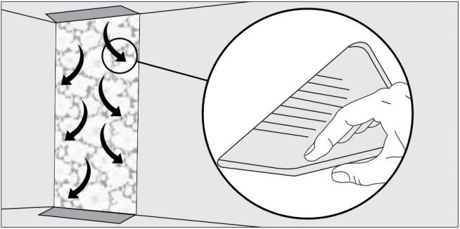 Направление разглаживания обоев резиновым или пластмассовым шпателем