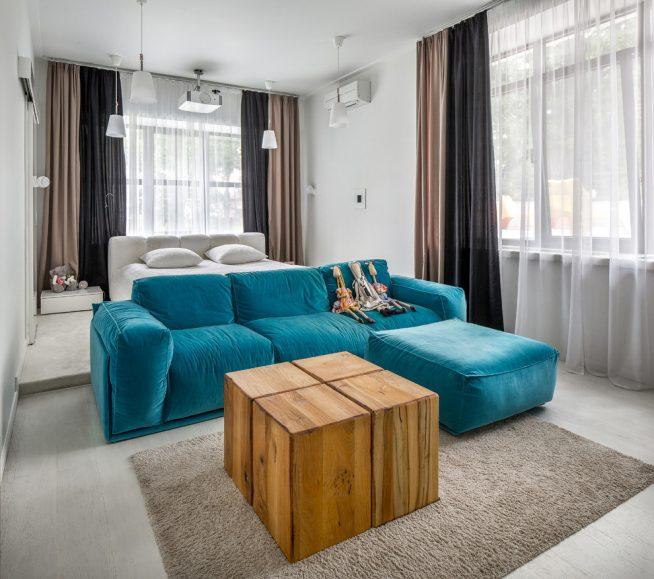 Зонирование комнаты угловым диваном