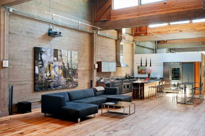 Интерьер в стиле лофт просторной квартиры-студии